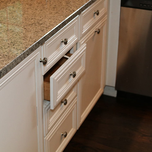 SureCatch® Lower Drawer Adhesive Latch holding a drawer open