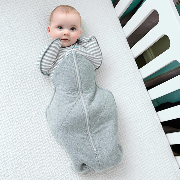 SWADDLE UP™ Warm with a baby in a crib