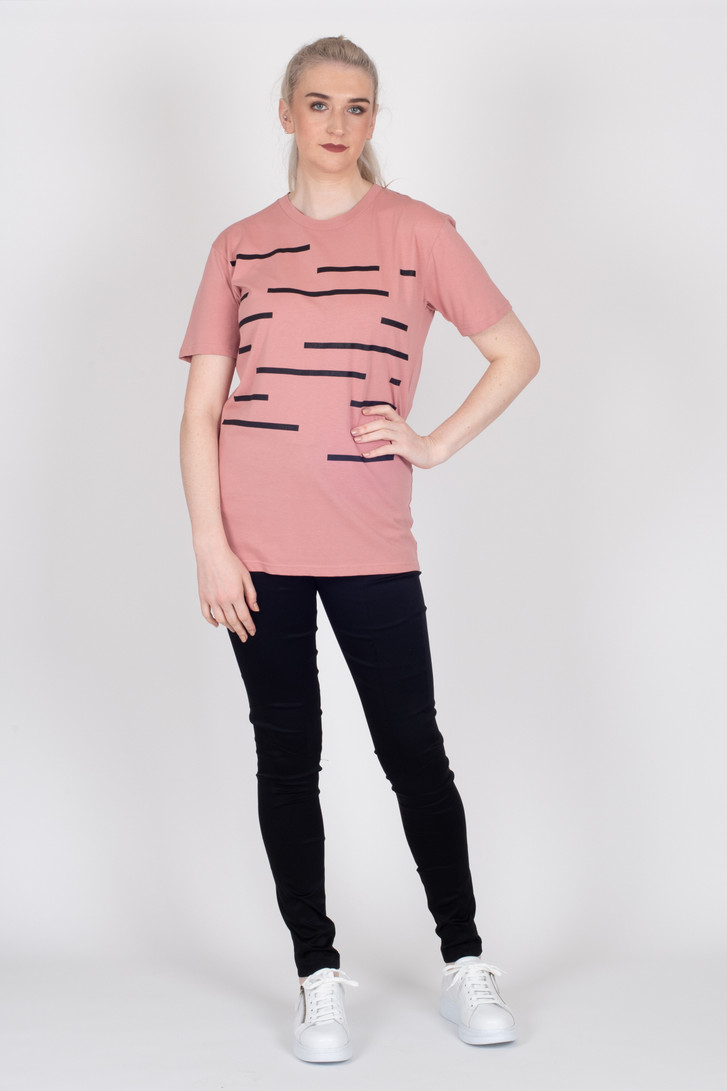 Tall woman modelling pink T shirt with black pants, both made longer for tall women